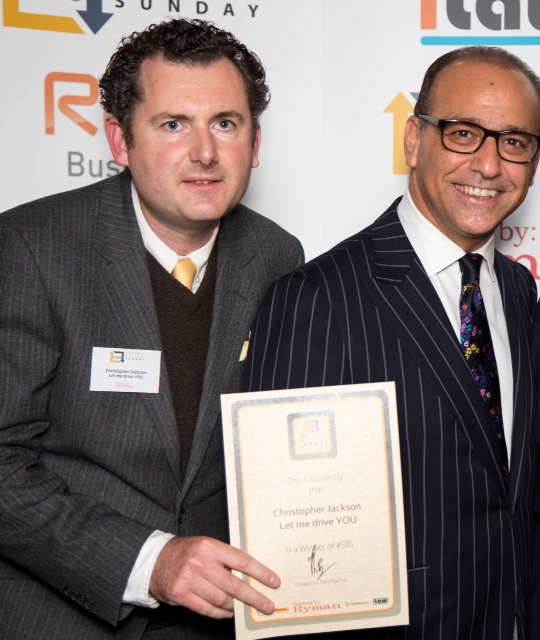 Chris Jackson Collects his SBS Award from Theo Paphitis