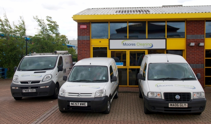 Moores Cleaning - Vans at the Office