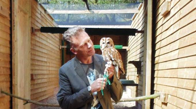 Chris Packham with a Shy Owl