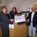 Hampshire County Council handover the cheque to Abbotts Ann Village Shop