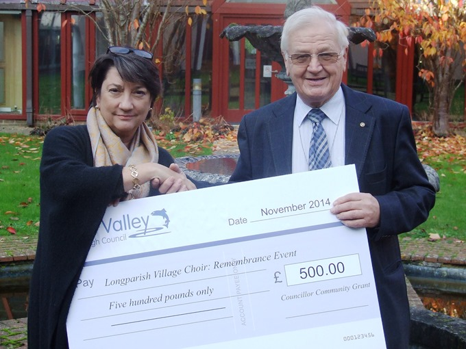 Cathy Yelf receives grant cheque from Cllr Jim Neal