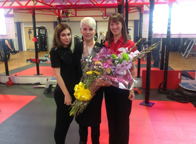 Jess Browning presents Mercedes and her daughter with flowers