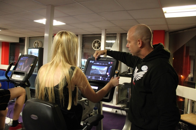 Instructor AL Darmanin demonstrates how to use the new treadmills to a gym member