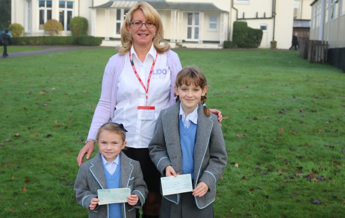 Julie Page (Lucy's mum) and two pupils from the school