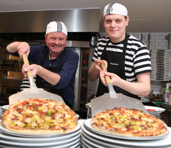 The official opening. PizzaExpress Superfan George de Watteville (left) takes out his favourite pizza, a Diavolo Classic, with pizzaiolo Nathan Elsey