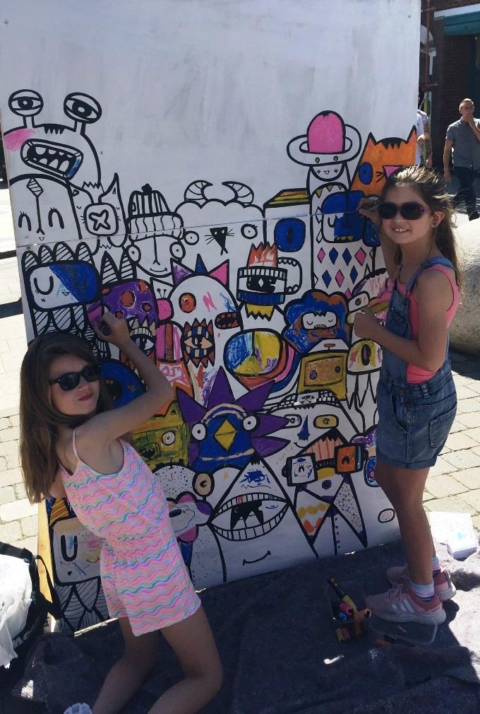 Four Fun Fridays - Melody & Ella Jones enjoy colouring Kev Munday's mural